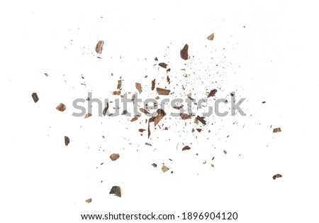 Wood pieces and dust, crushed tree bark isolated on white background, organic texture, top view
