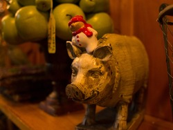 Wood pig sculpture with a snwoman