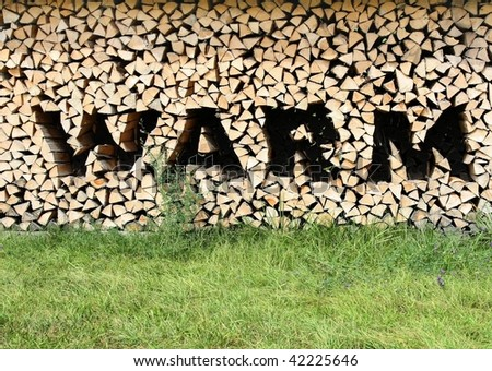 Wood Pile with letters of warm