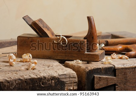 Wood planer and shavings at carpenters workshop