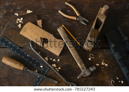 Wood planer and shavings at carpenters workshop. Joiner's tools