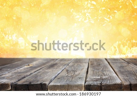 wood planks and golden light background . ready for product display.