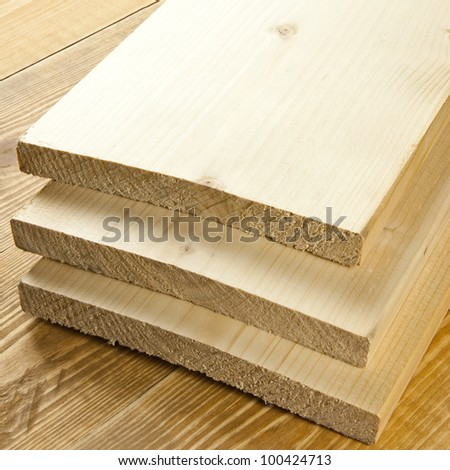 Wood planks are on a wooden board