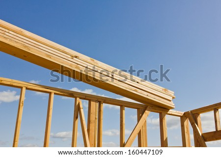 Wood planks are ready to be used in the construction of a roof