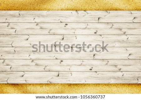 Wood planks board is over sand background