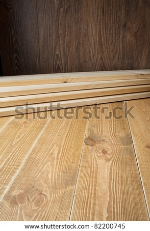 Wood planks on wooden floor. Can be used as construction, renovation, carpentry background.