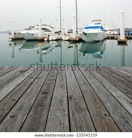 Wood platform beside yachts at marina. #133541159