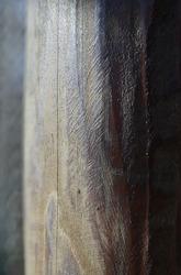 wood pole in the sun, part blurry, macro shot