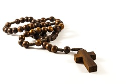 Wood rosary and cross with isolated background