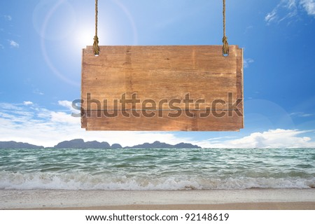 wood sign hanging on beach