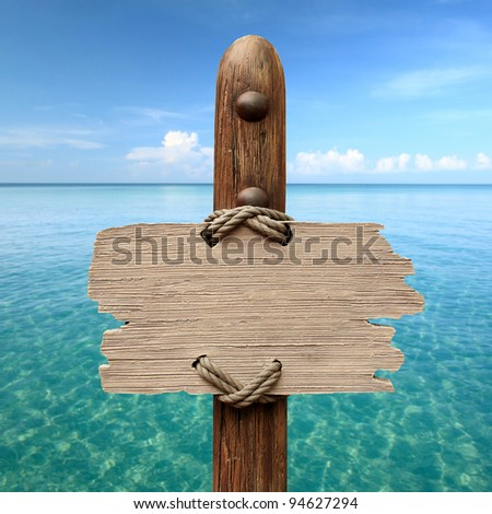 wood sign on the sea background