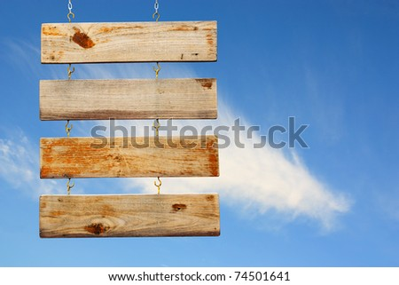 Wood Sign Over Blue Sky