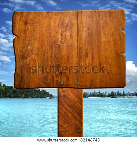 wood sign with ocean background - stock photo