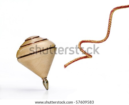 Wood spinning top on white background and string.