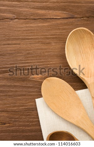 wood spoon as utensils on wooden background