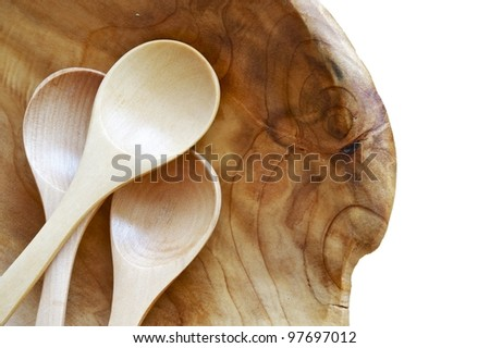 Wood Spoons in Unique Wood Bowl. Isolated on White. Wooden Kitchen Equipment Closeup.