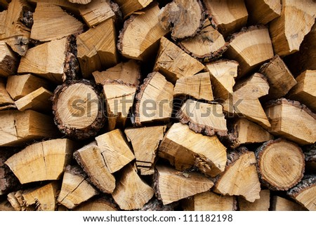 Wood stacked and dried for use in fuel