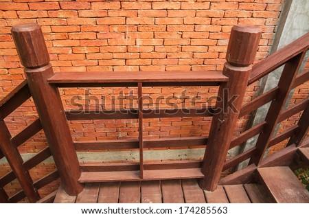 Wood stair and brick wall