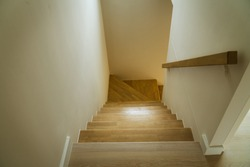 wood stair in warm white house