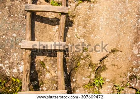 wood stair on big rock