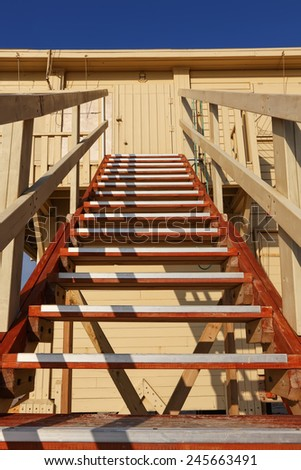 Wood stairs going up to a rescuer beach house