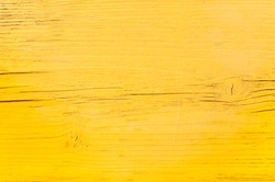 wood surface with yellow color paint