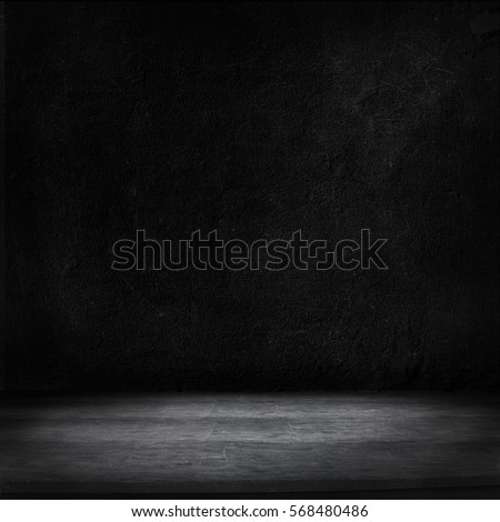 Wood table and black concrete wall background.