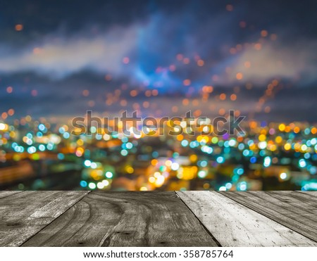 wood table and blur lights from Chiang Mai, Thailand in night time for background usage . #358785764