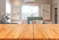 Wood table in modern home room interior with empty copy space on the table for product display mockup. Furniture design and home decoration concept.