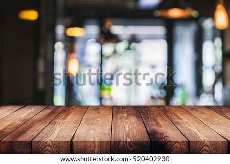 wood table on blur of cafe, coffee shop, bar, background - can used for display or montage your products #520402930