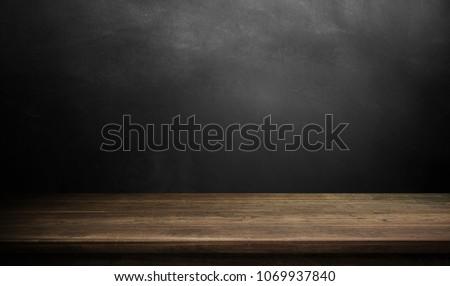 Wood table on dark background.