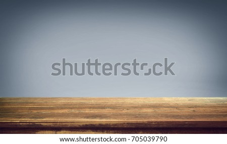 Wood table on gradient background.