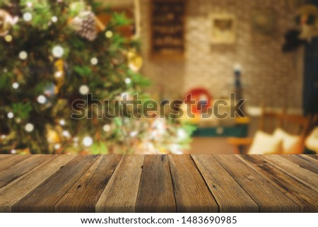 Wood table over Christmas tree with decoration blur background. can be used for display or montage products. #1483690985