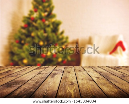 Wood table over Christmas tree with decoration blur background. can be used for display or montage products. #1545334004