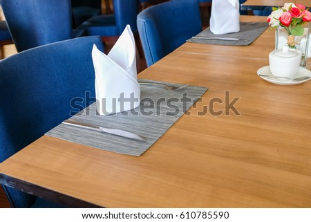 wood table set up for dinning room at hotel