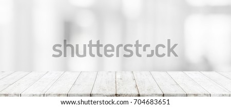Wood table top and blurred abstract background from interior building banner background - can used for display or montage your products.