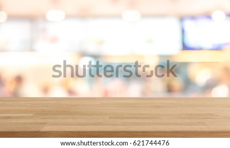Wood table top and blurred restaurant kitchen interior background - can used for display or montage your products. #621744476