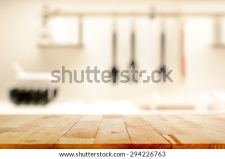 Wood table top (as kitchen island) on blur kitchen background - can be used for display or montage your products