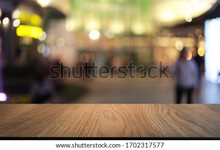 Wood Table Top in Blur Background room interior with empty copy space