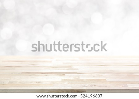 Wood table top on  abstract white bokeh, Christmas and festive theme background