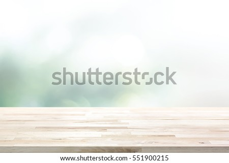 Wood table top on  blur abstract white green bokeh background - can be used for display products (or food)