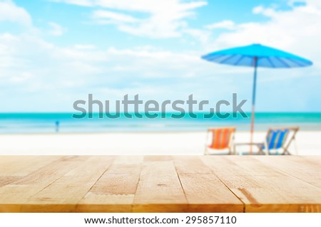 stock photo wood table top on blur beach background with beach chairs and parasol can be used for display or 295857110 - Каталог — Фотообои «Море, пляж»
