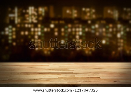 Wood table top on blur blue background bokeh - can be used for display or montage your products. #1217049325