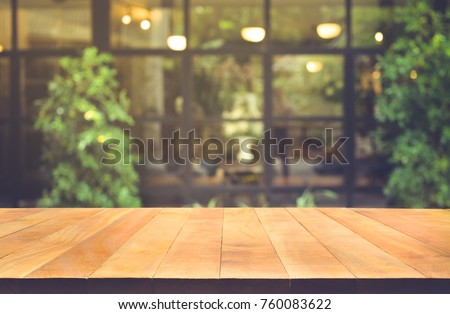 Wood Table Top On Blur Glass Wall Cafe Background.For Create Product  Display Or Design