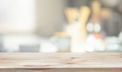 Wood table top on blur kitchen counter background.For montage product display or design key visual layout.