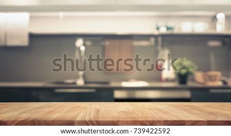 Wood table top on blur kitchen room background .For montage product display or design key visual layout. #739422592