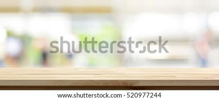 Wood table top on blur kitchen window background, panoramic banner - can be used for display or montage your products (or foods) #520977244
