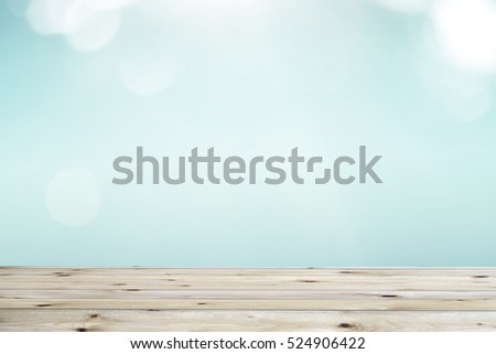 Wood table top on blur nature background, used for montage or display your products