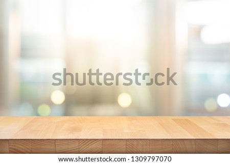 Wood table top on blur window glass,wall background.For montage product display or design key visual layout background. - Image #1309797070