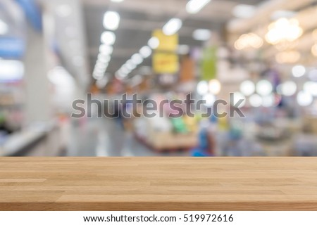 Wood table top on blur with bokeh shopping mall background - can be used for display or montage your products #519972616